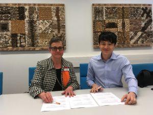 Seija Katajisto and Tung Hai are signing memorandum of understanding
