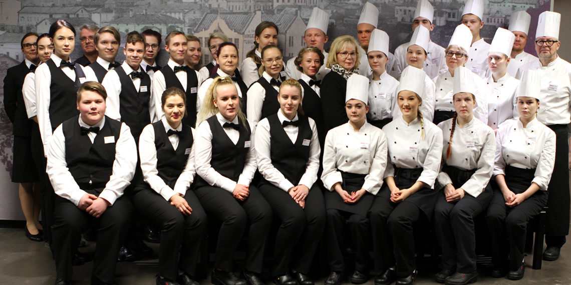 Group of cooks and waiters